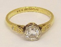 Lot 240: 18ct Platnum & Yellow Gold 0.50ct Diamond Solitaire Ring.20thc. The 0.50ct VVS1 G-J diamond solitaire in a classic 8 claw setting with a further 0.25 cts of diamonds on the shoulders. Marked 18ct.Platinum. Size N. Boxed.