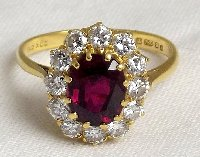 Lot 242: Fine 18ct Yellow Gold 2ct Natural Ruby and 0.65ct Diamonds Oval Engagement Ring or July Birthstone Ring. Hallmarked .750. Size P. Boxed.