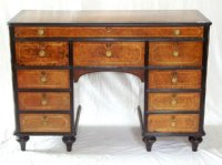 Lot 342: Georgian Kneehole Desk in Amboyna with Ebony Crossbandings,Bone Inlays. c1820. Pull out secretaire top drawer all on turned tulip supports. Height. 31in. Width. 44in. Depth. 18 1/2in.