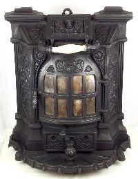 Lot 392: Good French Deville Art Nouveau Decorative Cast Iron Stove. Early 1900s. Height 24 in. Width 19 in. Depth 12 in.