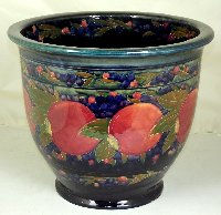 Lot 382: Moorcroft Jardiniere / Planter with Pomegranate Decoration on Blue Ground. Height 12 inches. Diameter 14.25 inches.