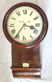 Lot 305: Rare Antique GWR Signal Box Clock .Ivorine Number Plate No GWR 414. From Drws-Y-Nant Signal Box Aberystwyth and Welsh Coast Railway. c1870. Mahogany standard Great Western drop dial clock. Chain Fusee movement with shaped plates,12 in Dial Height 26 in. Working order. Complete with original key.