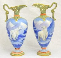 Lot 229: Rare pair of Grainger Royal Worcester 'Polar Bear' Retriculated Porcelain Urns. Circa 1897.  Having decoration of four polar bears standing on a glacier. Puce mark to base No. 965,Date code G.  Height 6.5 in. 1st Quality. (2 Items)