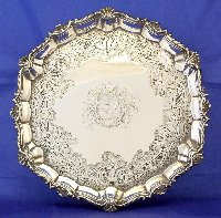 Lot 235: Silver 18thc Georgian Armorial Butlers Tray by Charles Wright c 1781. Hallmarked London. 920gm. Diameter 30 cm.