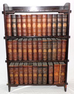 Complete Antique Set of 35 Leather Bound Encyclopedia Britannica's from 1875-1903 (9th edition). To include:33 enclclopedias, 1 volume of maps and 1 Index complete with original oak bookcase made for the set. Height 51 in. Width 35 in. Depth 10 in. Antique Auctioneers Wrexham Whitchurch Shrewsbury Liverpool Warrington Chester Mold Oswestry Llandudno