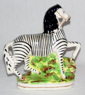 Antique Staffordshire Figure of a Zebra. Mid.19th Century. Height 9inches Antique Auctions Wrexham Whitchurch Shrewsbury Liverpool Warrington Chester Mold Oswestry Llandudno