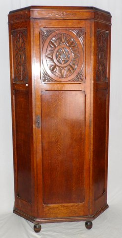 1920s Carved Oak Hall Robe. Quality,carved top with canted moulded corners,standing on ball feet.The single door with carved panel opening to reveal hanging hooks x7,mirror and shelf. Height 77 in. Width 35 in. Depth 16 in. Antiques Wrexham Whitchurch Shrewsbury Liverpool Warrington Chester Mold Oswestry Llandudno