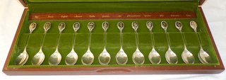 Set of twelve Sterling Silver Royal Horticultural Society  Flower Spoons by John Pinches Ltd. Hallmarked Sheffield, 1973 with the 1773 date letter to commemorate the Sheffield Assay Office bicentenary, 10oz, 311g, in fitted teak case. (12 Items)