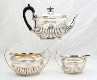 Fine Victorian Sterling Silver Tea Set Modelled in the Regency Style by Walker & Hall. Hallmarked Sheffield 1893. The teapot, cream jug and sugar bowl is embellished with fluted decoration and floral, leaf chased designs.The interiours of the cream jug and sugar bowl are gilded.