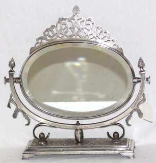 Rare Antique Signed Silver Islamic Persian Bevelled Oval Mirror. Hand made with fine engraved bird and folate decoration. Marked (Jafari?). .84 fineness.  Height 14 inches.